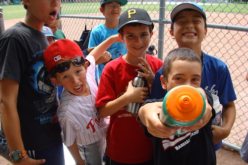 Kids celebrating at our Basketball, Baseball, Flag Football and Soccer summer camps in Toronto
